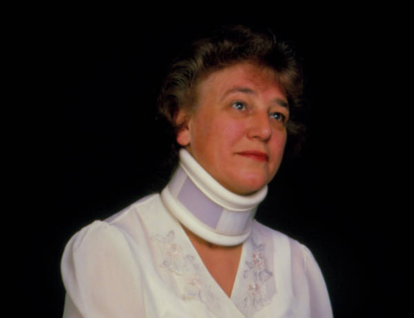 Neck Brace Photograph - Orthopaedic Neck Collar On A Woman (winter) by Alex Bartel/science Photo Library