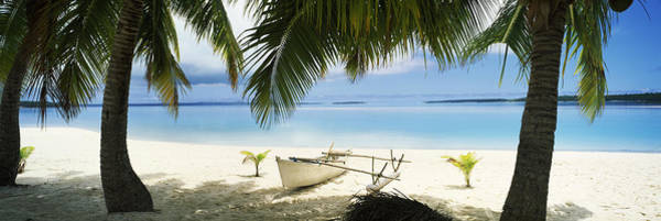 Polynesia Wall Art - Photograph - Outrigger Boat On The Beach, Aitutaki by Panoramic Images