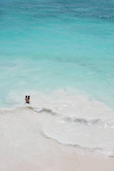Mayan Riviera Photograph - Overhead Of Mother Holding Daughter In by Holger Leue