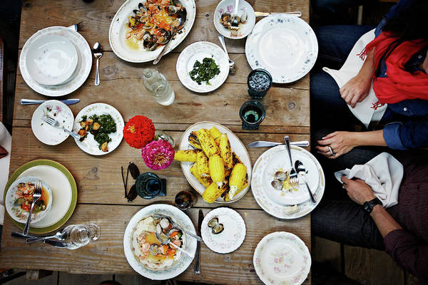 Real People Photograph - Overhead View Of Friends Dining Mid-meal by Thomas Barwick
