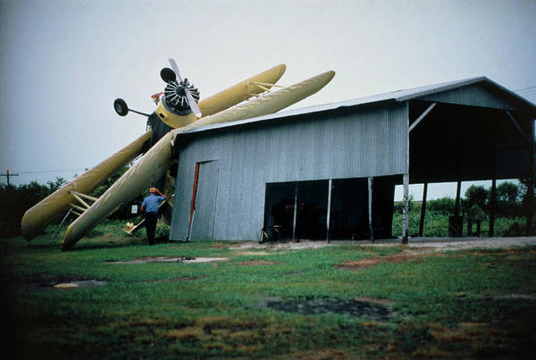 Severe Wall Art - Photograph - Overturned Light Airplane During Tornado by Graeme Ewens/science Photo Library