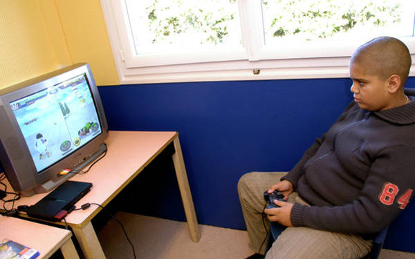 Game Room Photograph - Overweight Boy Playing A Computer Game by Aj Photo/hpr Bullion/science Photo Library