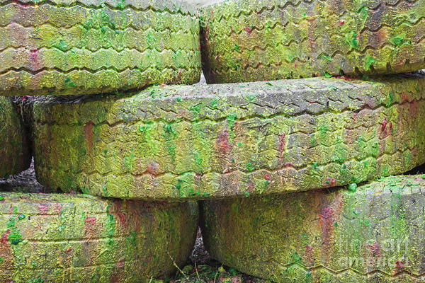 Photograph - Paint Covered Barricade Made Of Tires On Paintball Field by Bryan Mullennix