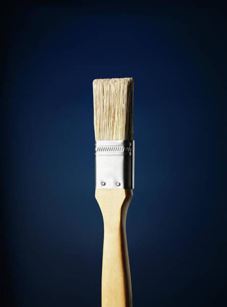Blue Background Photograph - Paintbrush Against A Blue Background by Stuart Minzey