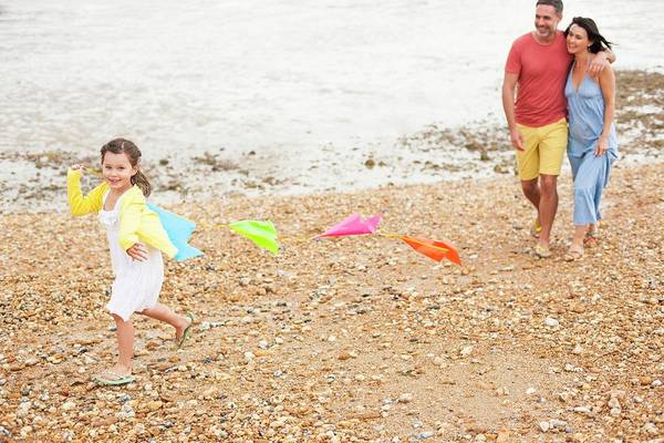 Wall Art - Photograph - Parents On Beach With Daughter by Ian Hooton