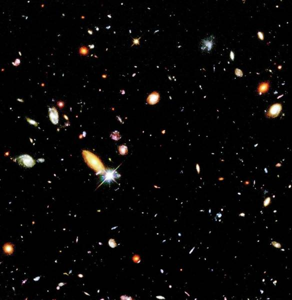 Photograph - Part Of The Hubble Deep Field by Robert Williams And The Hubble Deep Field Team (stsci) And Nasa/science Photo Library