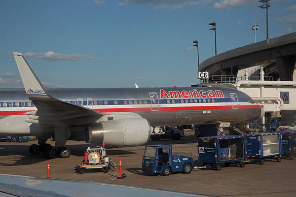Fort Worth Photograph - Passenger Airliner At An Airport by Jim West