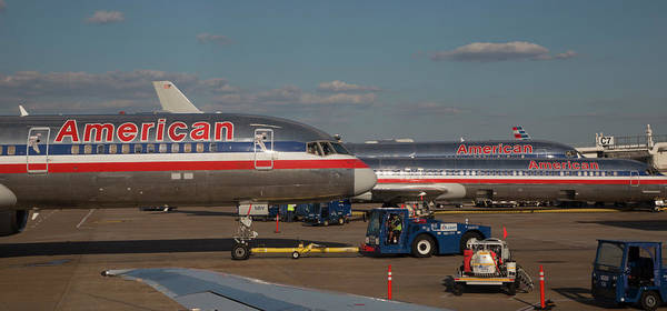 Fort Worth Photograph - Passenger Airliners At An Airport by Jim West