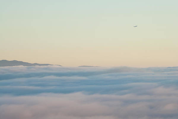 Taking Off Photograph - Passenger Jet Climbs Above Clouds And by Noah Clayton