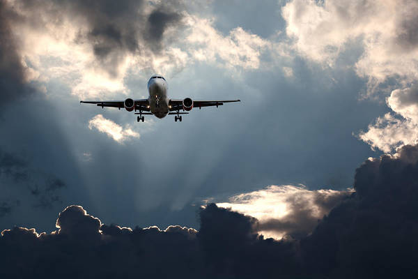 Wall Art - Photograph - Passenger Plane On Final Approach Against A Stormy Sky by Ken Biggs