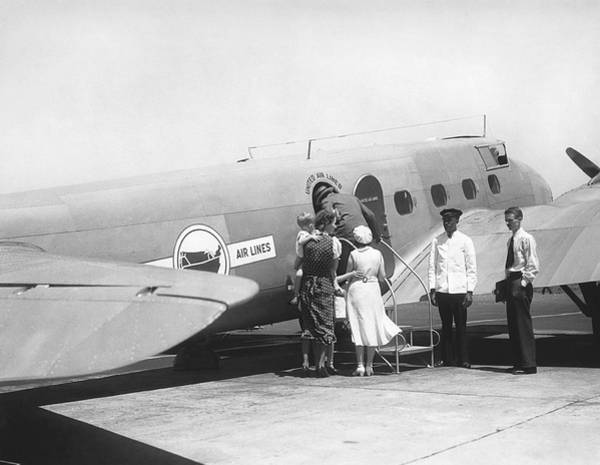 Wall Art - Photograph - Passengers Boarding Airplane by Underwood Archives