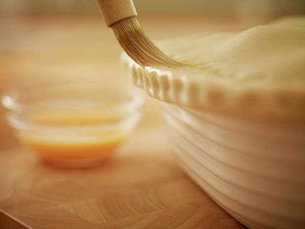 Items Photograph - Pastry Being Brushed With Egg Wash by Adam Gault