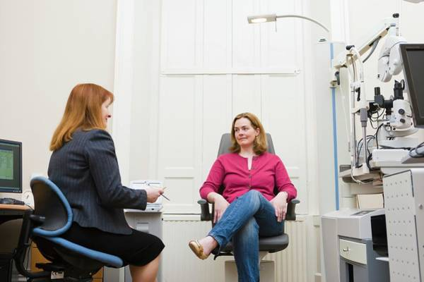 Doctor Office Photograph - Patient And Optometrist by Gustoimages/science Photo Library