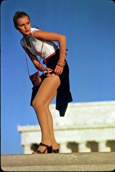 Bending Over Photograph - Patti Hansen Adjusting Her Skirt by Arthur Elgort