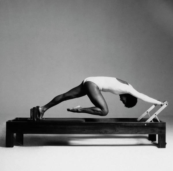 Wall Art - Photograph - Paula Kelly Exercising On The 'reformer' Machine by Francesco Scavullo