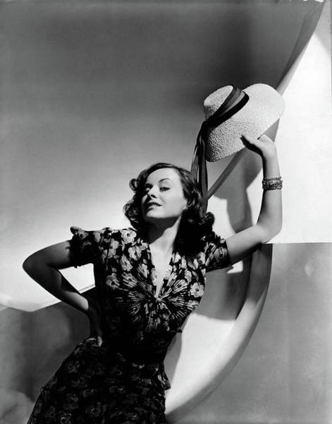 Sun Hat Photograph - Paulette Goddard Holding A Straw Hat by Horst P. Horst