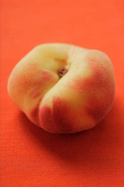 Wall Art - Photograph - Peach (old Variety) On Orange Background by Foodcollection