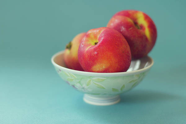 Healthy Lifestyle Photograph - Peaches In Bowl On Blue Background by Copyright Anna Nemoy(xaomena)