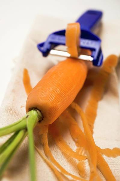 Wall Art - Photograph - Peeling A Carrot by Foodcollection