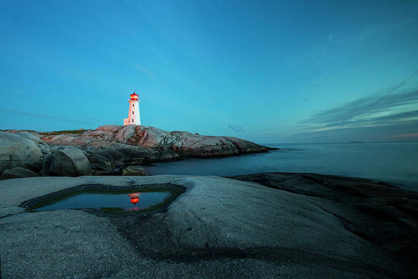 Robbie Photograph - Peggys Point Lighthouse Illuminates by Robbie George