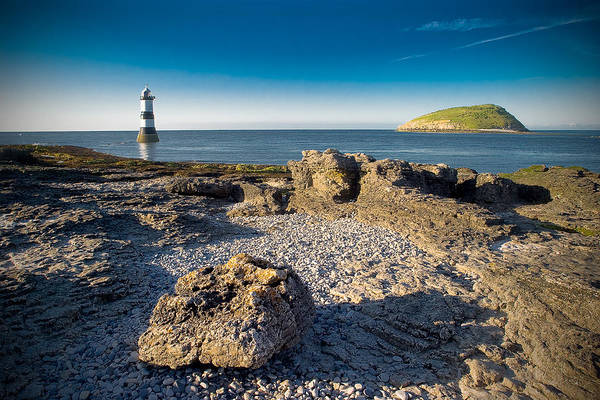 Photograph - Penmon Lighthouse And Puffin Island by Peter OReilly
