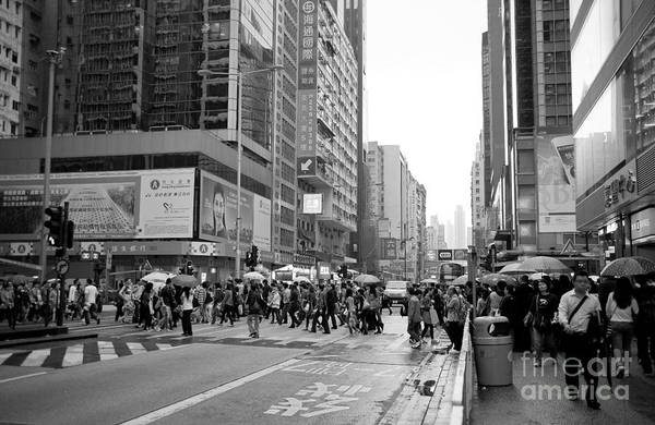 Walking In The Rain Wall Art - Photograph - People Crossing The Street On A Rainy Day In Mong Kok Hong Kong by Ivy Ho