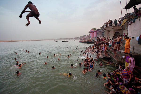 Wall Art - Photograph - People Jumping Into The Sacred Ganges by John Stanmeyer