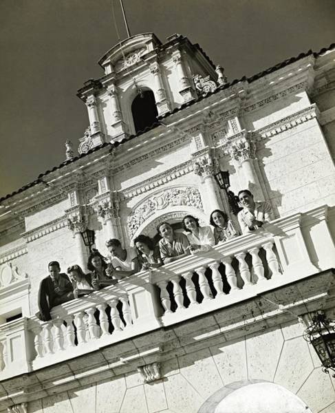 Photograph - People On A Balcony Of The Jaimanitas-biltmore by Toni Frissell