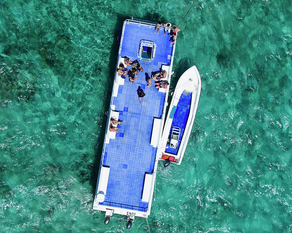 Snorkeling Photograph - People On Deck Of A Boat by Tommy Clarke