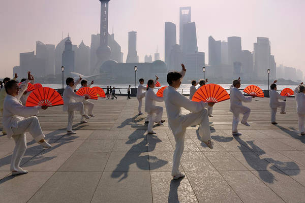 Wall Art - Photograph - People Practicing Taiji With Red Fans by Keren Su