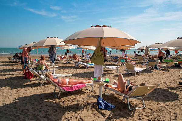 Beach Holiday Photograph - People Relax On Lido Beach by Holger Leue