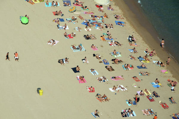 Beach Holiday Photograph - People Relaxing On Beach by Etienne Girardet