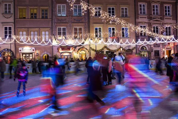 Tenement Photograph - People Skating On Ice Rink At Christmas Time In Warsaw by Artur Bogacki