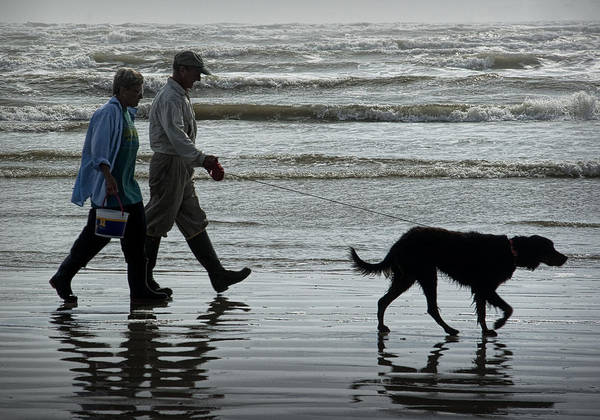 Photograph - People Walking The Dog Along The Beach by Randall Nyhof