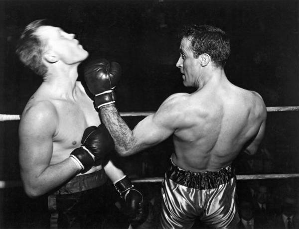 Nightime Photograph - Perfect Form Uppercut by Underwood Archives