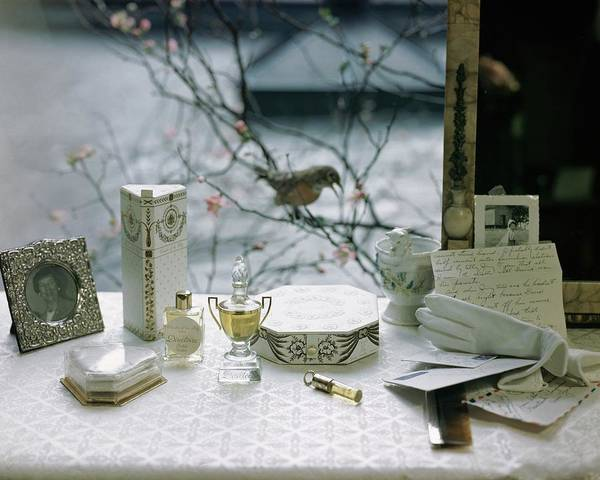 Perfume Photograph - Perfume And Accessories On A Vanity Table by Frances McLaughlin-Gill