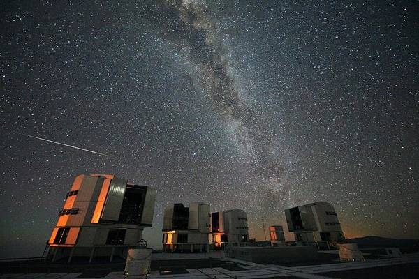 Perseid Wall Art - Photograph - Perseid Meteor Over Vlt Telescopes by Stephane Guisard/european Southern Observatory/science Photo Library