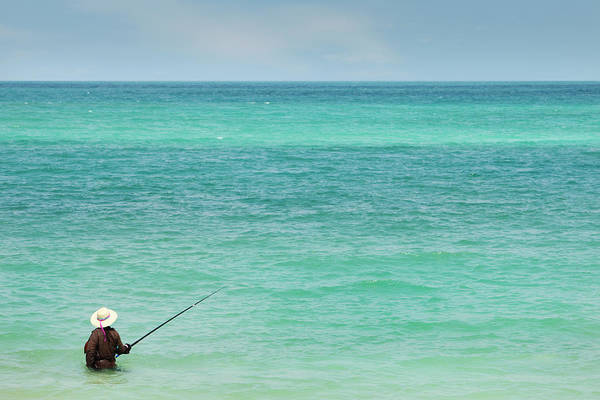 Rod Taylor Photograph - Person Fishing In Ocean Off Koh Pangan by Paul Taylor