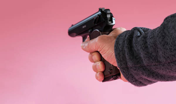 Space Gun Photograph - Person Holding Handgun Against A Pink Background by Wladimir Bulgar/science Photo Library