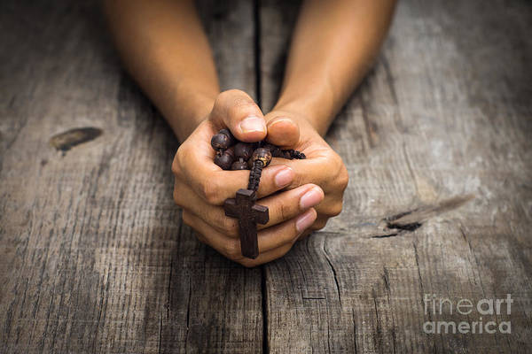 Crucifix Photograph - Person Praying by Aged Pixel