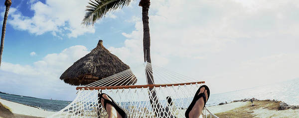 Flip Flops Photograph - Person Resting In Hammock On The Beach by Panoramic Images