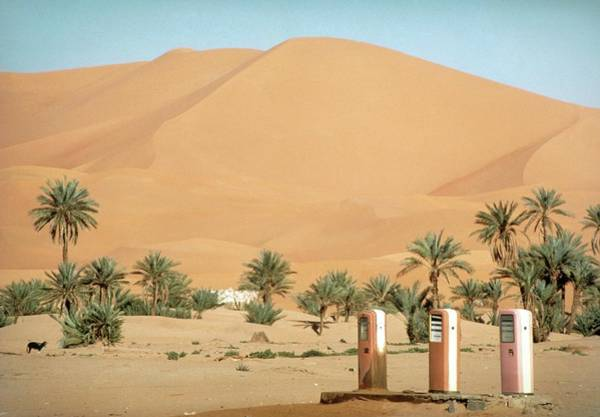 Pump Photograph - Petrol Pumps In Desert Near Kerzaz by Sinclair Stammers/science Photo Library