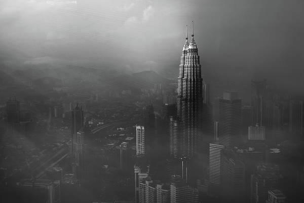 Aerials Photograph - Petronas Towers In A Foggy Afternoon by Nader El Assy