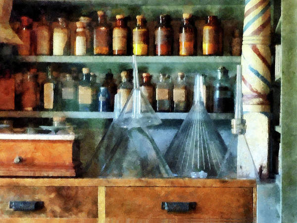 Photograph - Pharmacist - Glass Funnels And Barber Pole by Susan Savad
