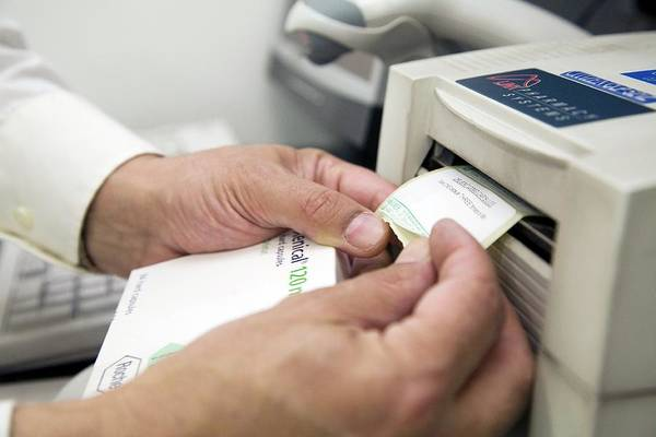 Printer Photograph - Pharmacist Scanning A Barcode by Mark Thomas/science Photo Library