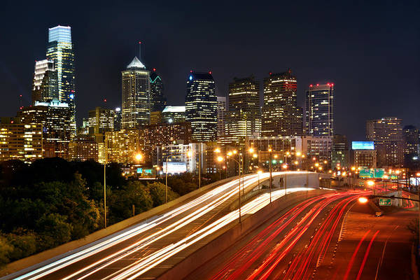 Philadelphia Photograph - Philadelphia Skyline At Night In Color Car Light Trails by Jon Holiday