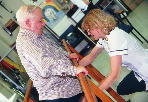 Posture Wall Art - Photograph - Physiotherapist Helping An Elderly Man Stand by Antonia Reeve/science Photo Library