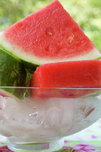 Watermellon Wall Art - Photograph - Pieces Of Watermelon In A Bowl Of Ice Cubes by Foodcollection