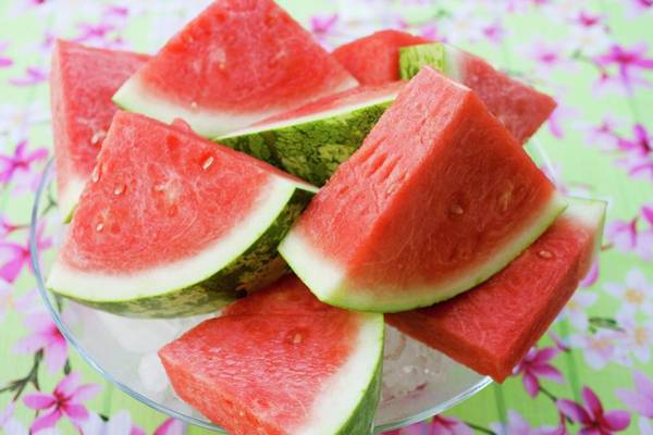 Wall Art - Photograph - Pieces Of Watermelon On A Glass Platter by Foodcollection