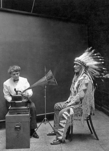 Elderly Wall Art - Photograph - Piegan Chief Having Voice Recorded by Underwood Archives